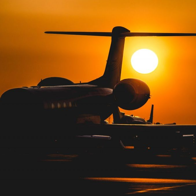 Plane with sunset in background