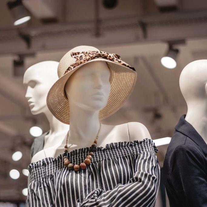 store mannequins with women's clothing and accessories
